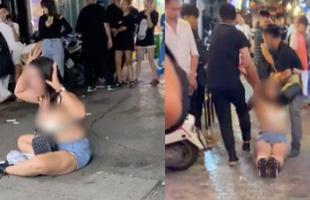 Người phụ nữ khóc lóc, lột đồ trước cửa quán bar 1900 sau khi bị nhân viên đưa ra ngoài: